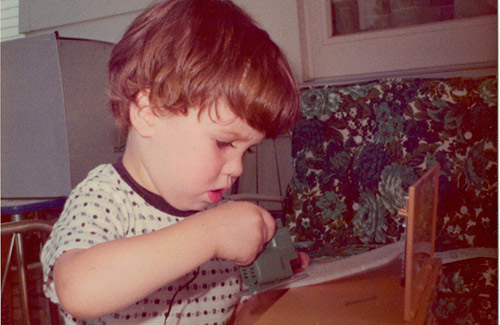 Little Joey intently cutting styrofoam with his jigsaw