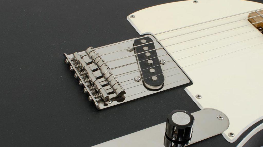 Modern Titanium Telecaster Bridge mounted on a RockRabbit guitar