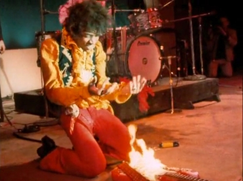 Jimi Hendrix burning a guitar